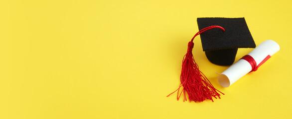 Academic hat with diploma on yellow background. Graduation theme - fototapety na wymiar
