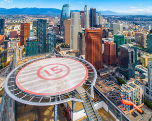 Aerial Shot of Downtown Los Angeles California. Beautiful stunning views of Downtown High Rise buildings and Rooftop Helipads. Beautiful Sunny day. - fototapety na wymiar