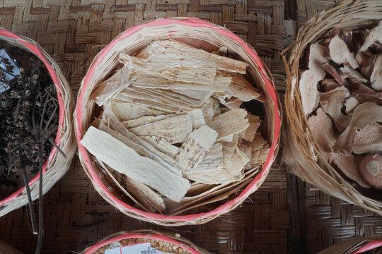 Dried Zingiber cassumunar Roxb in bamboo basket. medicinal plants. Thai herbs.