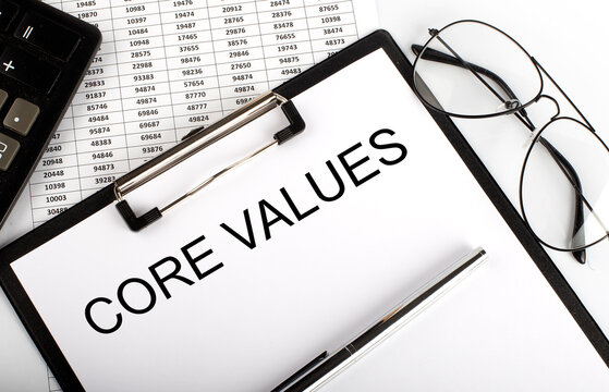 Paper with text Core Values on the table on chart