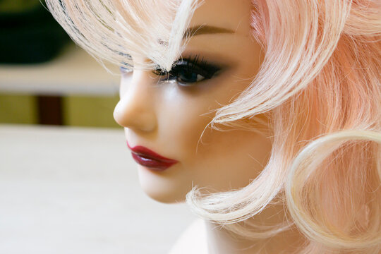 Mannequin Woman head  with hairstyle  on dark background.