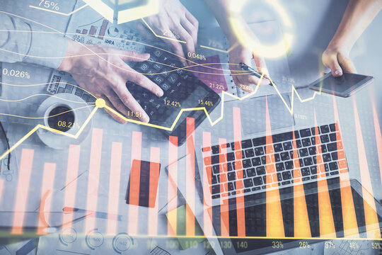 Double exposure of man and woman working together and financial chart hologram drawing. market analysis concept. Computer background. Top View.