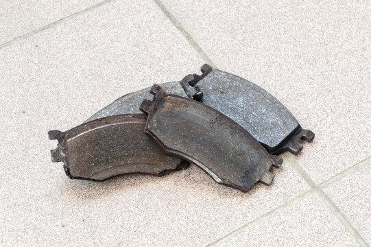 Old worn out car brake pads.