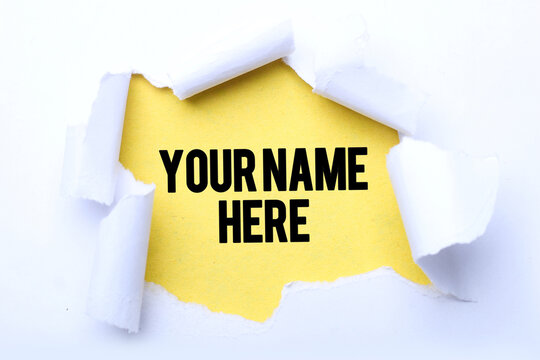 Your name here text on paper