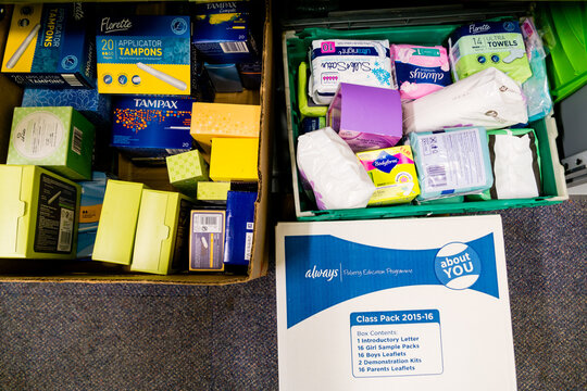 ROTHERHAM, ENGLAND - MAY 31, 2018: A local church Trussell Trust food bank dealing with period poverty - a selection of the sanitary products that have been donated in boxes