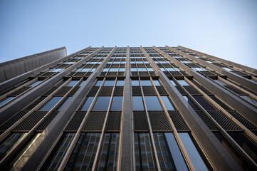 Fototapeta Skyscraper agains a blue sky.