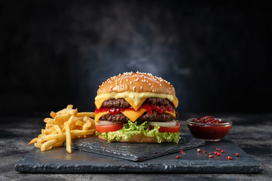 Fresh tasty burger on dark background