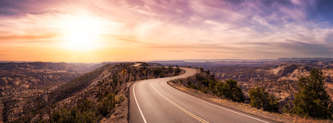 Obraz Panoramic View of a scenic route on top of a mountain ridge in the desert. Colorul Sunset Sky Art Render. Taken on Route 12, Utah, United States of America. - fototapety do salonu