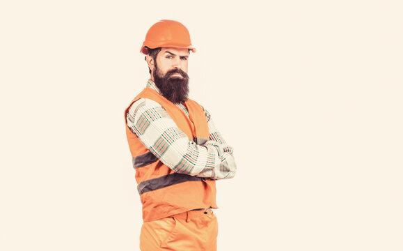 Builder in hard hat, foreman or repairman in the helmet. Man builders, industry. Worker in construction uniform. Architect builder. Bearded man worker with beard in building helmet or hard hat