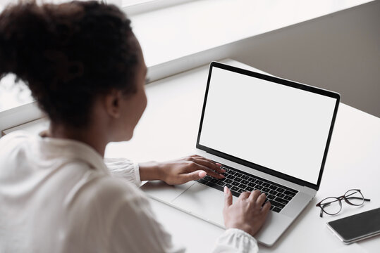Young woman using laptop computer at home. Business woman working in office. Freelance, student lifestyle, e-learning, studying, web site, technology and online shopping concept