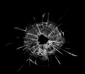 Bullet hole in the glass. Isolated on a black background. - fototapety na wymiar