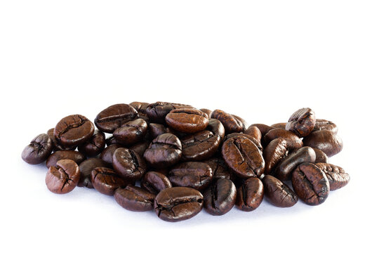 Roasted coffee beans on white background, Stack Focus