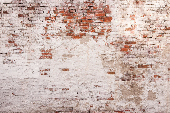 Abstract red white stonewall urban texture. Old red brick wall with shabby damaged white plaster. Painted whitewashed brickwall grungy background. Stonework frame grunge empty wallpaper.