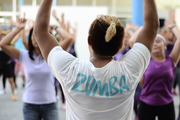 Zumba instructor in session