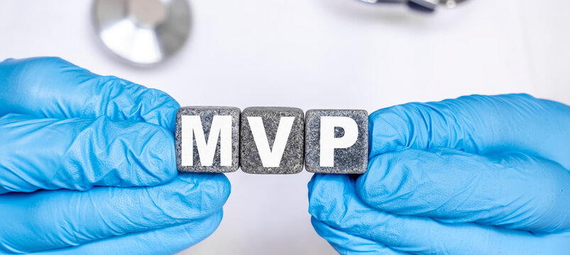 MVP Mitral valve prolapse - word from stone blocks with letters holding by a doctor's hands in medical protective gloves