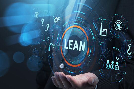 Businessman holding on hand virtual flowchart of lean quality control and manufacturing process management concept in business, six sigma. virtual interface with cogwheels.