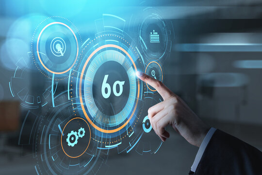 Businessman hand, finger pushing a virtual button on digital interface. Six sigma, quality control and manufacturing process management concept on screen.