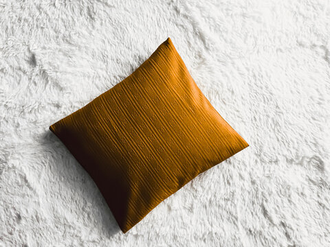 Golden cushion throw pillow on white fluffy plaid blanket as flat lay background, bedroom top view and home decor flatlay