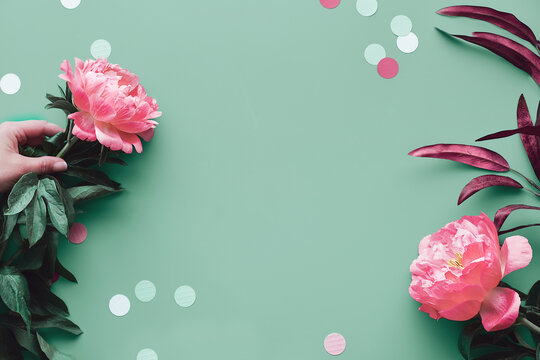 Greeting card design with pink peony flowers on faded green background, text space. Trendy casual natural eco friendly top view. Summer birthday, Mother's day greeting card design.