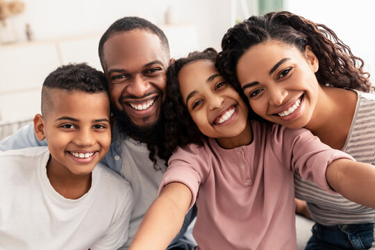 Portrait of african american family taking a selfie together at home