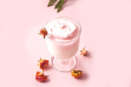 Glass of rose iced Dalgona whipped drink coffee