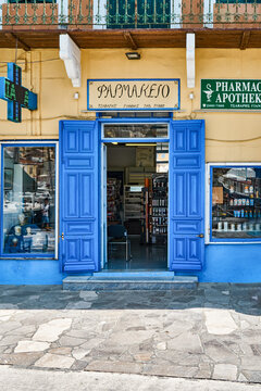 Symi, Greece - July 05 2017: Pharmacy with beautiful entrance doors inside of old house on town street