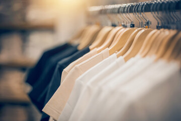 T-shirts on hangers. Shopping in store. Clothes on hangers in shop for sale