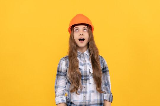 look here. childhood development. happy labour day. future career. teen girl in helmet.