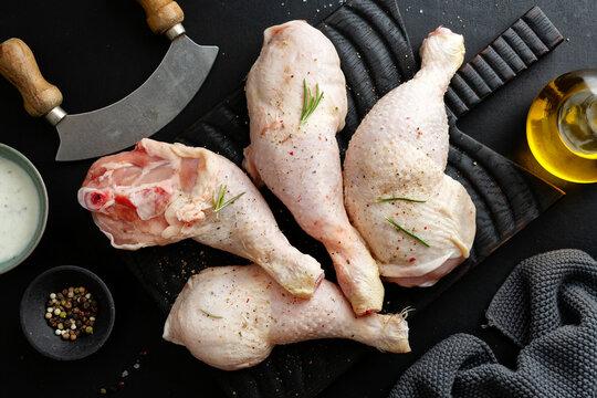 Raw chicken legs on board