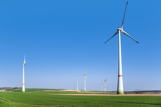 Wind generators in the field . energy of nature