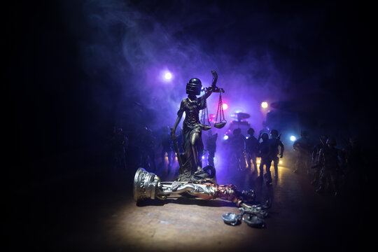 Law concept. Miniature colorful artwork decoration with fog and backlight. The Statue of Justice - lady justice or Iustitia Justitia the Roman goddess of Justice. Selective focus