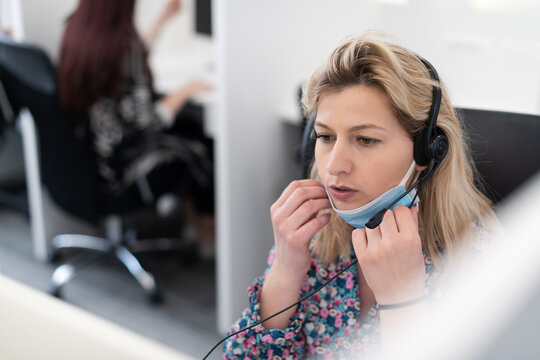 call center operator in medical mask