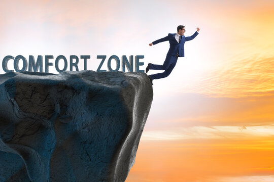Businessman in the concept of stepping out of comfort zone