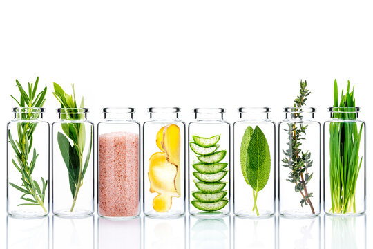 Alternative skin care and homemade scrubs with natural ingredients  in glass bottles isolate on white background.