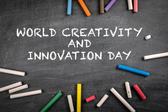 World Creativity and Innovation Day on 21 April. Colored pieces of chalk on a dark chalk board