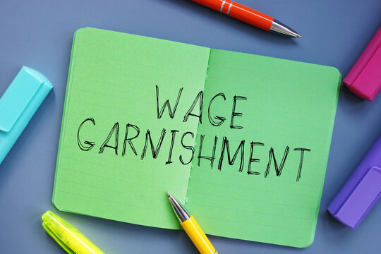 Financial concept meaning Wage Garnishment with sign on the sheet.