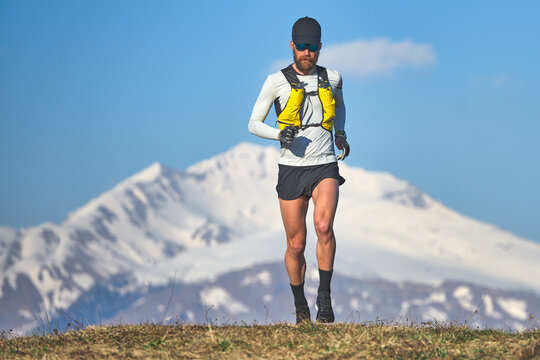 Man travel athlete in the mountains in high altitude