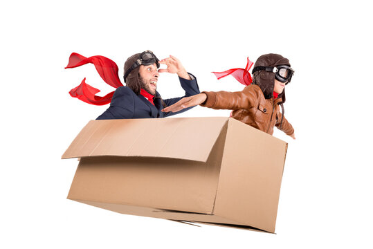 Father and son in a cardboard box