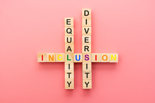Inclusion, diversity and equality concept. Lgbtq abstract letters on wooden cubes over pink background.