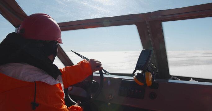 Close up of coast guard team sailing rescue boat in arctic