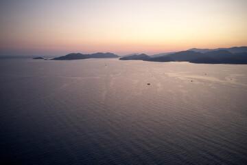 Fototapeta Picturesque sunset over the sea.