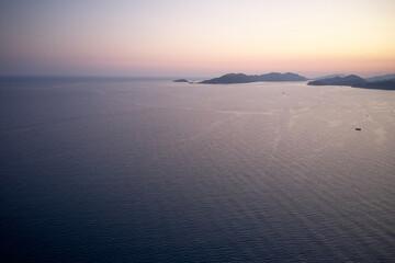 Fototapeta Colorful sunset over the mountains and the sea.