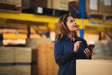 Fototapeta African American worker in warehouse, woman manager checking the store stock, business industry storage report working in warehouse, logistic online shipping service concept