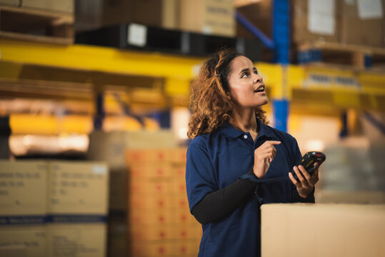 African American worker in warehouse, woman manager checking the store stock, business industry storage report working in warehouse, logistic online shipping service concept