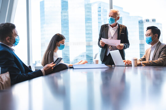 business worker team meeting talk with surgical face mask, new normal lifestyle wearing mask and have social distancing isolation, flu disease epidemic protect, coronavirus COVID-19 protection concept