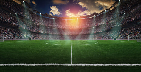 Football lies in the smoke on stadium grass