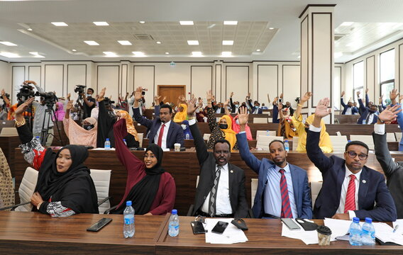 Somali legislators of the lower house of parliament raise their hands to vote to extend President Mohamed Abdullahi Mohamed's term for another two years to let the country prepare for direct elections, in Mogadishu