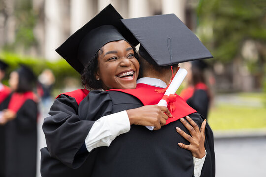 Happy african american couple students hugging, closeup