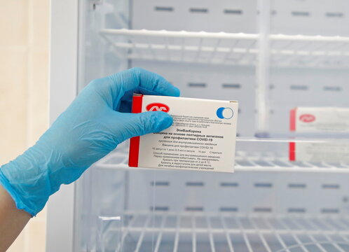 A medical worker holds a box containing vials of the EpiVacCorona COVID-19 vaccine in Saint Petersburg