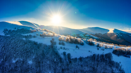 Fototapeta Wonderful landscapes of the Carpathian Mountains covered with snow and clear blue sky in Ukraine near the village of Pylypets.